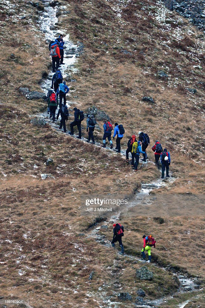 Climbers make their way into Glencoe on January 20,2012 in Glencoe, Scotland. Four climbers were killed yesterday following and avalanche on Bidean Nam Bian in Glencoe, A party of six, three men and three women were descending close to Church Door Buttress when the snow slope broke away.