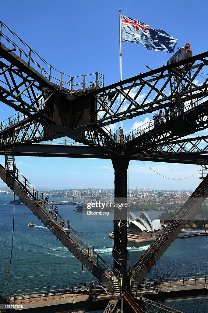 Climbers make their way towards the summit as they scale the Sydney Harbour Bridge during a guided tour operated by BridgeClimb in Sydney, Australia, on Monday, Dec. 24, 2012. Beginning next month, people wanting to ascend 134 meters above sea level to the top of the bridge spanning Sydney Harbour will have the option to hear guides speak Mandarin. Photographer: Brendon Thorne/Bloomberg via Getty Images
