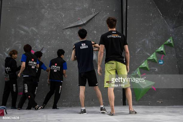 Climbers observe the boulders prior the final at the IFSC Climbing World Cup Munich on August 19 2017 in Munich Germany