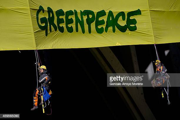 Climbers of Greenpeace hang a banner from the Segovia Viaduct supporting the right and the duty to fight for the protection of the environment on...