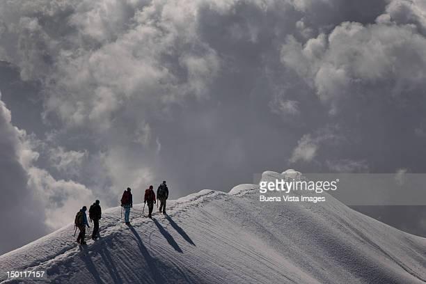 Climbers on a snowy mountain ridge