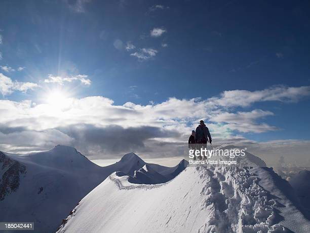 Climbers on a snowy ridge