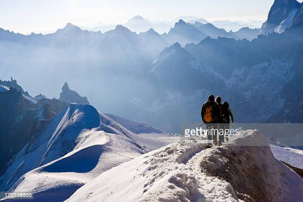 Climbers on mountain ridge