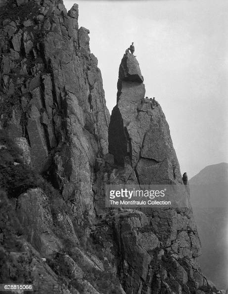 Climbers on the peak of Napes Needle a prominent mountain rock pinnacle some 20 metres high situated on the southern flank of Great Gable first...