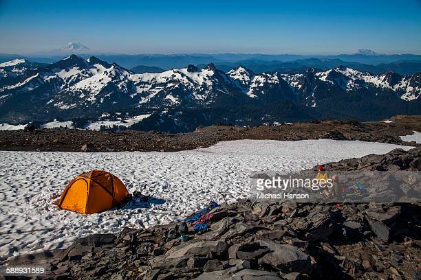 Climbers rest in their tents while ascending Mount Rainier in Mount Rainier National Park, Washington, USA.