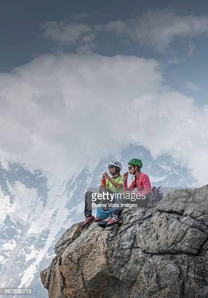 Climbers resting on a mountaintop