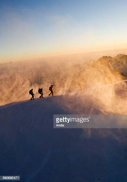 Climbers roped together upon arrival at the top of MontBlanc 4807 m