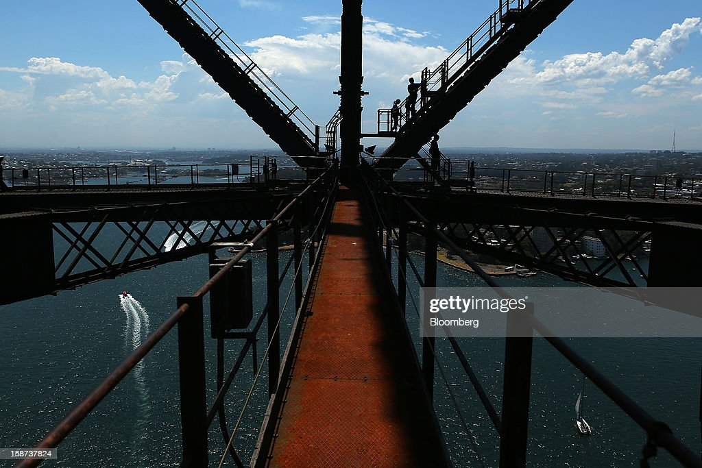 Climbers scale the Sydney Harbour Bridge during a guided tour operated by BridgeClimb in Sydney, Australia, on Monday, Dec. 24, 2012. Beginning next month, people wanting to ascend 134 meters above sea level to the top of the bridge spanning Sydney Harbour will have the option to hear guides speak Mandarin. Photographer: Brendon Thorne/Bloomberg via Getty Images