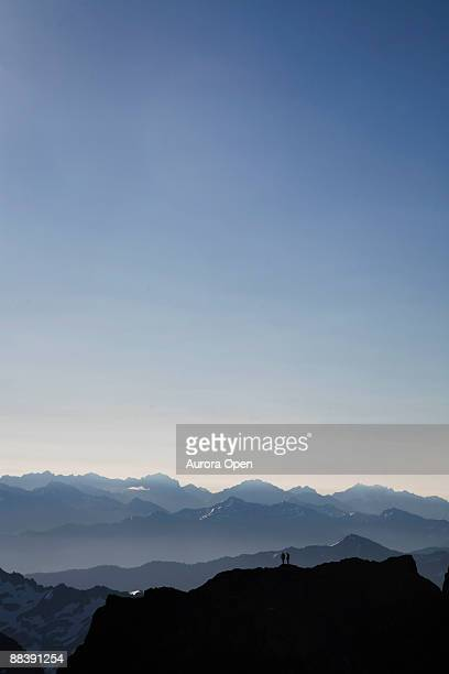 Climbers stand on a false summit while climbing a mountain in Olympic National Park,WA.