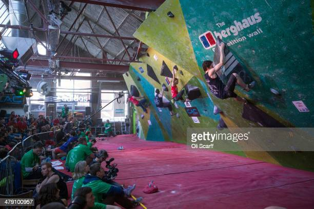 Climbers take part in the CWIF international bouldering competition on March 16 2014 in Sheffield England The 'Climbing Works International Festival'...