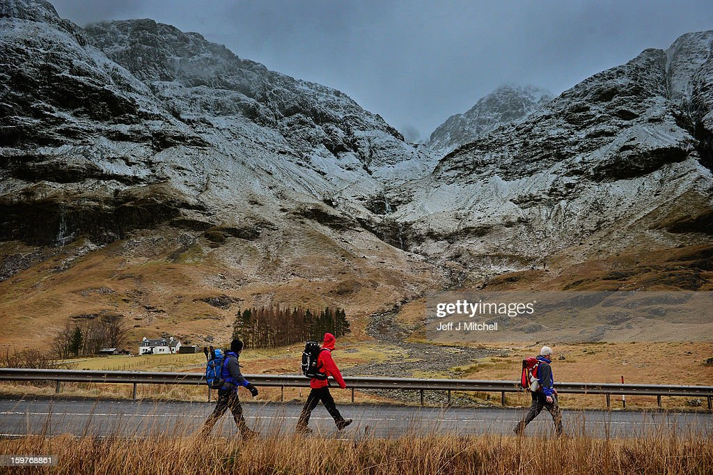 Climbers walk along the A82 next to Bidean Nam Bian on January 20,2012 in Glencoe, Scotland. Four climbers were killed yesterday following an avalanche on Bidean Nam Bian in Glencoe. A party of six, three men and three women were descending close to Church Door Buttress when the snow slope broke away.