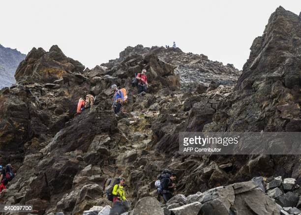 Climbers walk in the famous 'Couloir du Goûter' on the 'voie royale' route to climb atop the MontBlanc peak on August 27 2017 in the MontBlanc range...