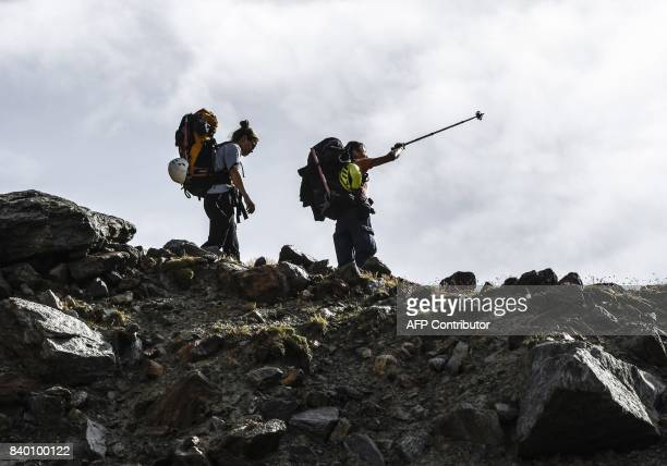 Climbers walk on the 'voie royale' route to climb atop the MontBlanc peak via the 'couloir du Goûter' on August 27 2017 in the MontBlanc range near...