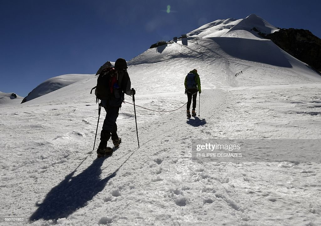Climbers walk to the Vallot refuge on August 25 on the normal way for climbing to the MontBlanc peak in Chamonix eastern France / AFP / PHILIPPE...