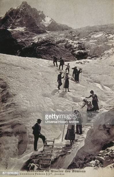 climbers walking across the Bossons Glacier in the Mont Blanc massif of the Alps in the Chamonix valley of HauteSavoie d_partement southeastern...