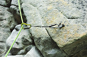Close-up of сlimbing quickdraw on a rock.
