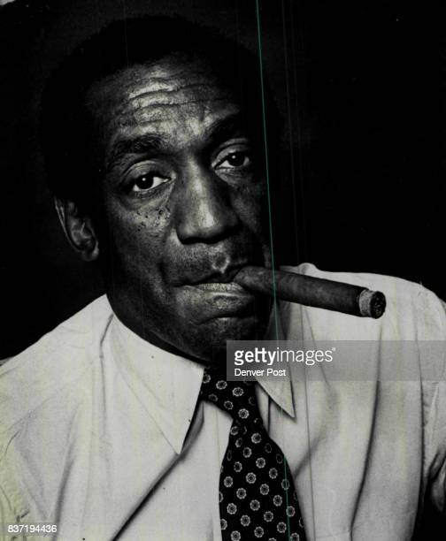 Clinching a cigar back stage Friday night at the turn of the century Bill Cosby gives his older and more sophisticated look Credit The Denver Post