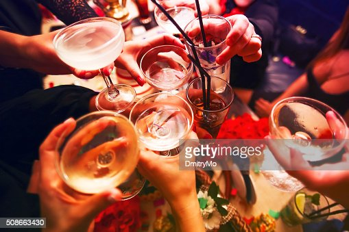 Clinking glasses and toasting : Stock Photo
