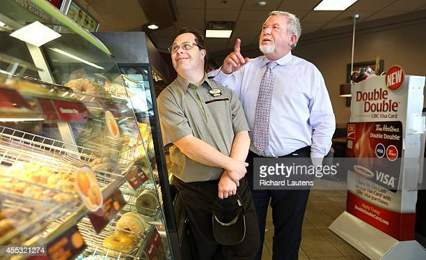 Clint and Mark have a chat in the restaurant 50 of the 250 employees of Tim Horton franchise owner Mark Wafer have disabilities Clint Sparling is one...