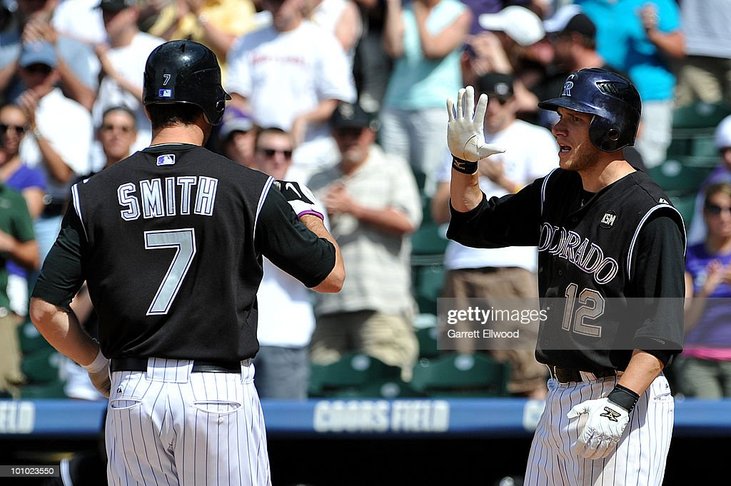 Clint Barmes #12 congratulates Seth Smith #7 of the Colorado Rockies during the game against the Arizona Diamondbacks at Coors Field on May 27, 2010 in Denver, Colorado.