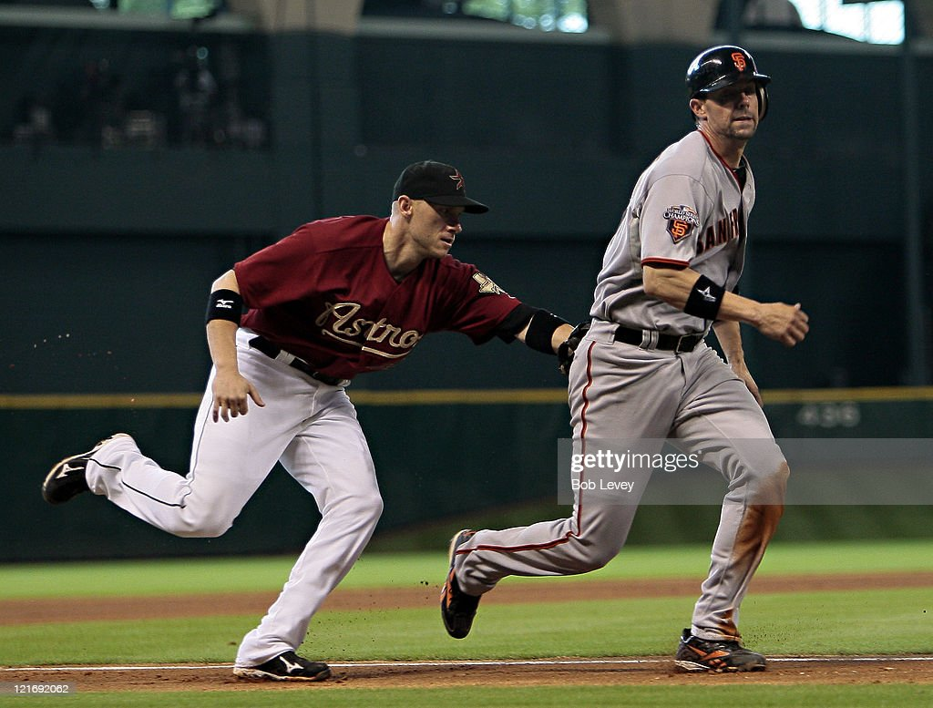 <a gi-track='captionPersonalityLinkClicked' href=/galleries/search?phrase=Clint+Barmes&family=editorial&specificpeople=208223 ng-click='$event.stopPropagation()'>Clint Barmes</a> #12 of the Houston Astros tags out Chris Stewart #37 of the San Francisco Giants after a run down at Minute Maid Park on August 21, 2011 in Houston, Texas.