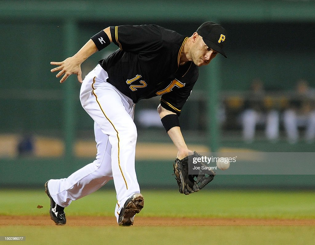 <a gi-track='captionPersonalityLinkClicked' href=/galleries/search?phrase=Clint+Barmes&family=editorial&specificpeople=208223 ng-click='$event.stopPropagation()'>Clint Barmes</a> #12 of the Pittsburgh Pirates fields a ground ball during the game against the Los Angeles Dodgers on August 14, 2012 at PNC Park in Pittsburgh, Pennsylvania. Los Angeles won the game 11-0.