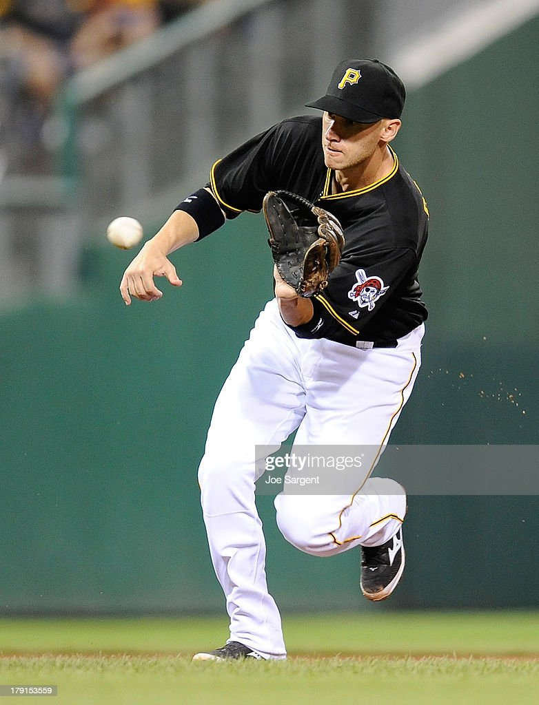 <a gi-track='captionPersonalityLinkClicked' href=/galleries/search?phrase=Clint+Barmes&family=editorial&specificpeople=208223 ng-click='$event.stopPropagation()'>Clint Barmes</a> #12 of the Pittsburgh Pirates fields a ground ball during the seventh inning against the St. Louis Cardinals on August 31, 2013 at PNC Park in Pittsburgh, Pennsylvania.