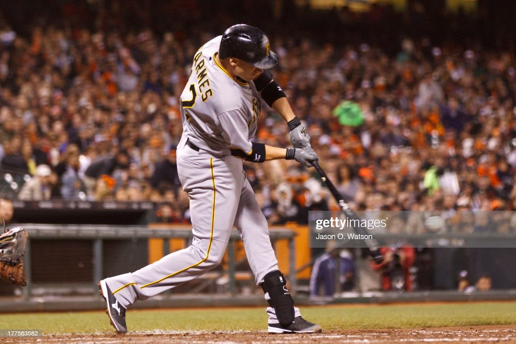 <a gi-track='captionPersonalityLinkClicked' href=/galleries/search?phrase=Clint+Barmes&family=editorial&specificpeople=208223 ng-click='$event.stopPropagation()'>Clint Barmes</a> #12 of the Pittsburgh Pirates hits a three run home run off of a pitch from Madison Bumgarner of the San Francisco Giants (not pictured) during the seventh inning at AT&T Park on August 23, 2013 in San Francisco, California.