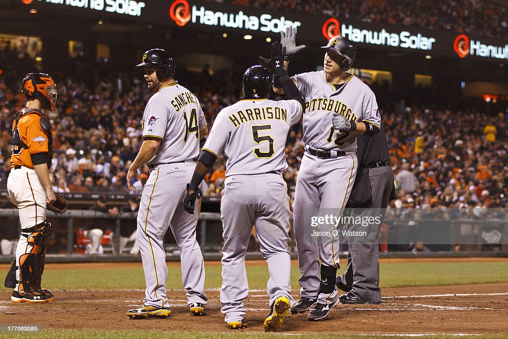 <a gi-track='captionPersonalityLinkClicked' href=/galleries/search?phrase=Clint+Barmes&family=editorial&specificpeople=208223 ng-click='$event.stopPropagation()'>Clint Barmes</a> #12 of the Pittsburgh Pirates is congratulated by Josh Harrison #5 and <a gi-track='captionPersonalityLinkClicked' href=/galleries/search?phrase=Gaby+Sanchez&family=editorial&specificpeople=4945789 ng-click='$event.stopPropagation()'>Gaby Sanchez</a> #14 after hitting a three run home run against the San Francisco Giants during the seventh inning at AT&T Park on August 23, 2013 in San Francisco, California.