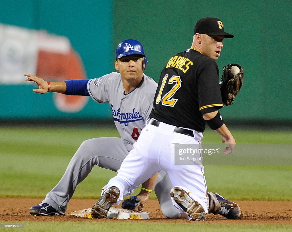 <a gi-track='captionPersonalityLinkClicked' href=/galleries/search?phrase=Clint+Barmes&family=editorial&specificpeople=208223 ng-click='$event.stopPropagation()'>Clint Barmes</a> #12 of the Pittsburgh Pirates looks back for the call after Luis Cruz #47 of the Los Angeles Dodgers safely slides into second base on August 14, 2012 at PNC Park in Pittsburgh, Pennsylvania.