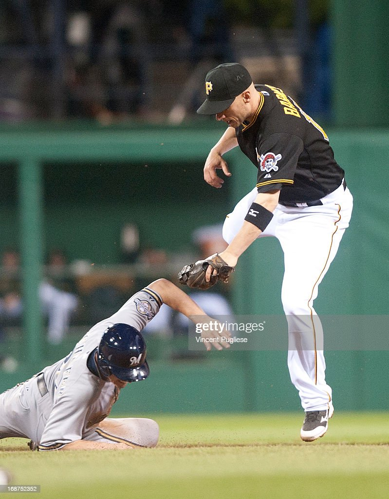 Clint Barmes #12 of the Pittsburgh Pirates puts the tag on Logan Schafer (22) of the Milwaukee Brewers at PNC Park on May 14, 2013 in Pittsburgh, Pennsylvania.