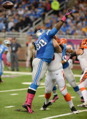 Clint Boling of the Cincinnati Bengals blocks Nick Fairley of the Detroit Lions during the game at Ford Field on October 20 2013 in Detroit Michigan...