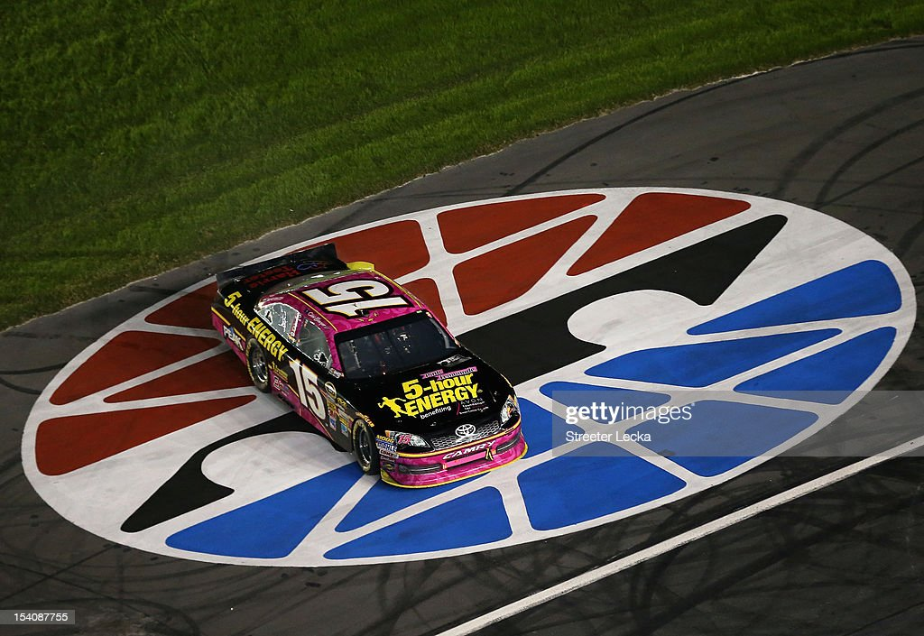 Clint Bowyer, driver of the #15 5-Hour Energy Benefiting Avon Foundation for Women Toyota, celebrates after winning the NASCAR Sprint Cup Series Bank of America 500 at Charlotte Motor Speedway in Concord, North Carolina.
