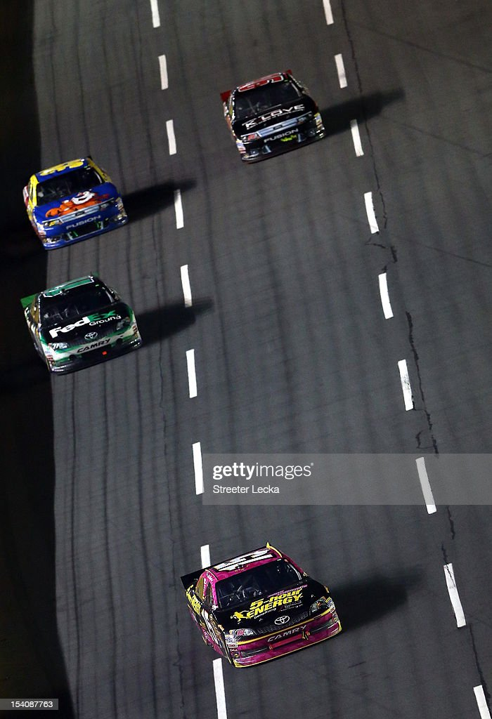 Clint Bowyer, driver of the #15 5-Hour Energy Benefiting Avon Foundation for Women Toyota, leads a group of cars during the NASCAR Sprint Cup Series Bank of America 500 at Charlotte Motor Speedway in Concord, North Carolina.