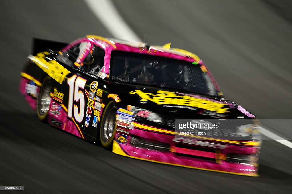 Clint Bowyer, driver of the #15 5-Hour Energy Benefiting Avon Foundation for Women Toyota, races during the NASCAR Sprint Cup Series Bank of America 500 at Charlotte Motor Speedway in Concord, North Carolina.