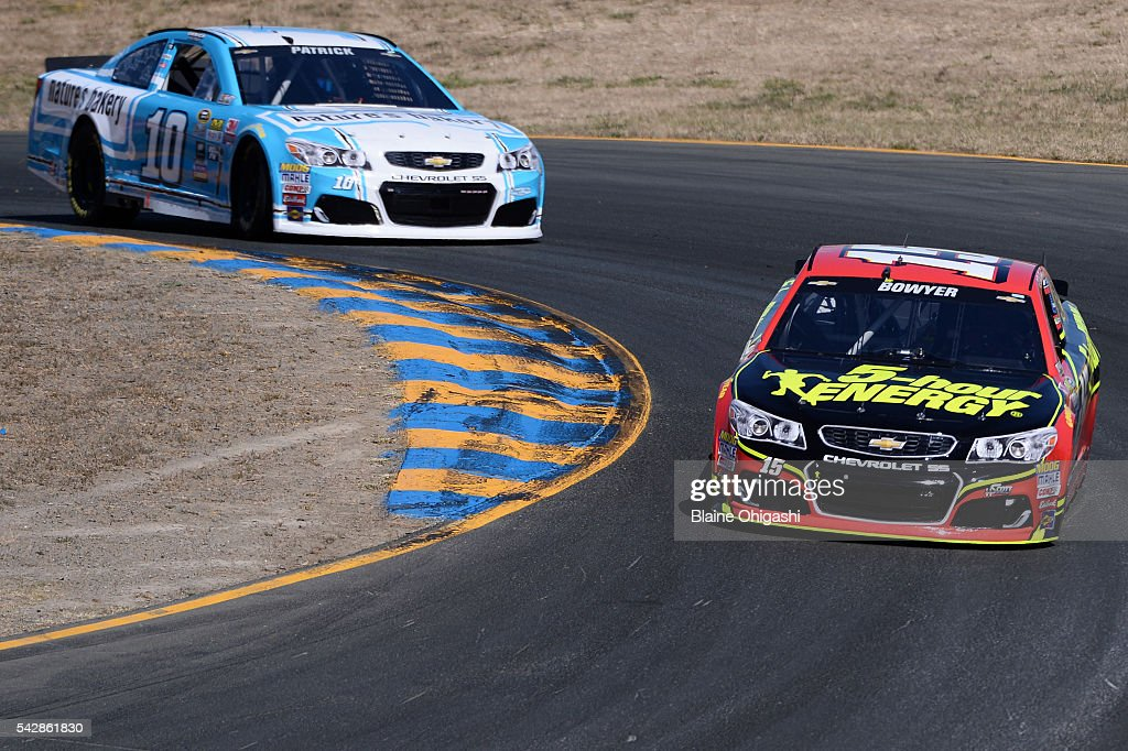 Clint Bowyer, driver of the #15 5-hour Energy Chevrolet, and Danica Patrick, driver of the #10 Nature's Bakery Chevrolet, drive during practice for the NASCAR Sprint Cup Series Toyota/Save Mart 350 at Sonoma Raceway on June 24, 2016 in Sonoma, California.