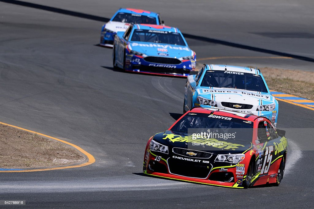 <a gi-track='captionPersonalityLinkClicked' href=/galleries/search?phrase=Clint+Bowyer&family=editorial&specificpeople=537951 ng-click='$event.stopPropagation()'>Clint Bowyer</a>, driver of the #15 5-hour Energy Chevrolet, <a gi-track='captionPersonalityLinkClicked' href=/galleries/search?phrase=Danica+Patrick&family=editorial&specificpeople=183352 ng-click='$event.stopPropagation()'>Danica Patrick</a>, driver of the #10 Nature's Bakery Chevrolet, and <a gi-track='captionPersonalityLinkClicked' href=/galleries/search?phrase=Aric+Almirola&family=editorial&specificpeople=574878 ng-click='$event.stopPropagation()'>Aric Almirola</a>, driver of the #43 Smithfield Ford, practice for the NASCAR Sprint Cup Series Toyota/Save Mart 350 at Sonoma Raceway on June 24, 2016 in Sonoma, California.
