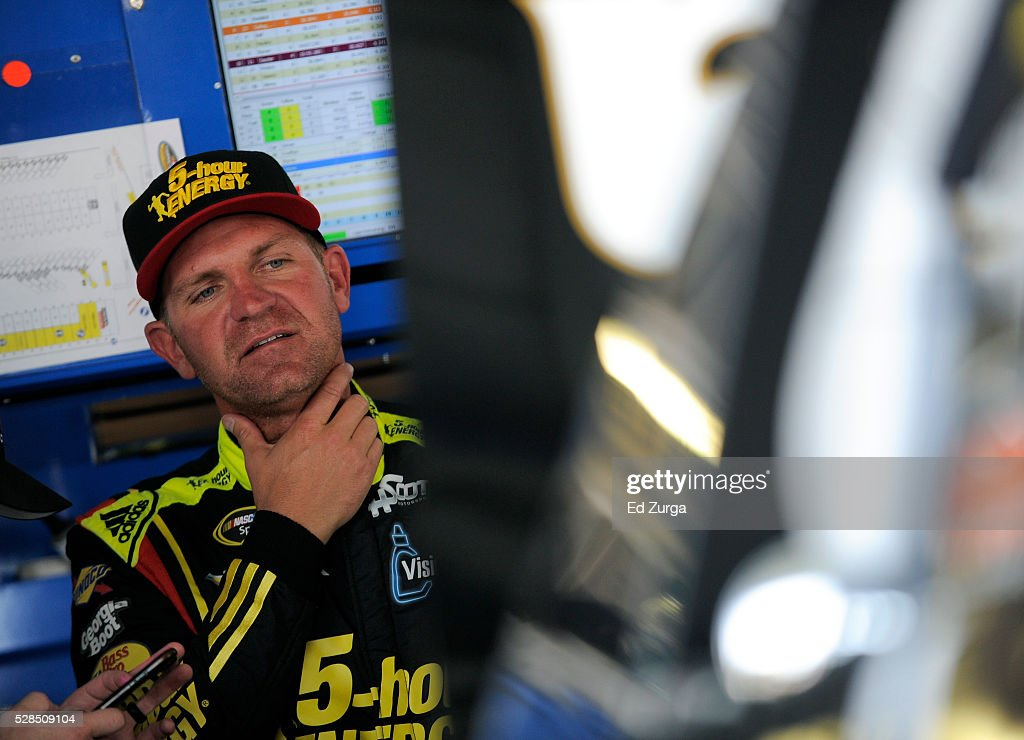 Clint Bowyer, driver of the #24 5-Hour Energy Chevrolet, looks at his car after a practice sessions for the Toyota Tundra 250 at Kansas Speedway on May 5, 2016 in Kansas City, Kansas.