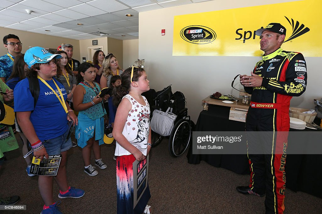 <a gi-track='captionPersonalityLinkClicked' href=/galleries/search?phrase=Clint+Bowyer&family=editorial&specificpeople=537951 ng-click='$event.stopPropagation()'>Clint Bowyer</a>, driver of the #15 5-hour Energy Chevrolet, speaks to former Make A Wish participants and their familes before practice for the NASCAR Sprint Cup Series Toyota/Save Mart 350 at Sonoma Raceway on June 24, 2016 in Sonoma, California.