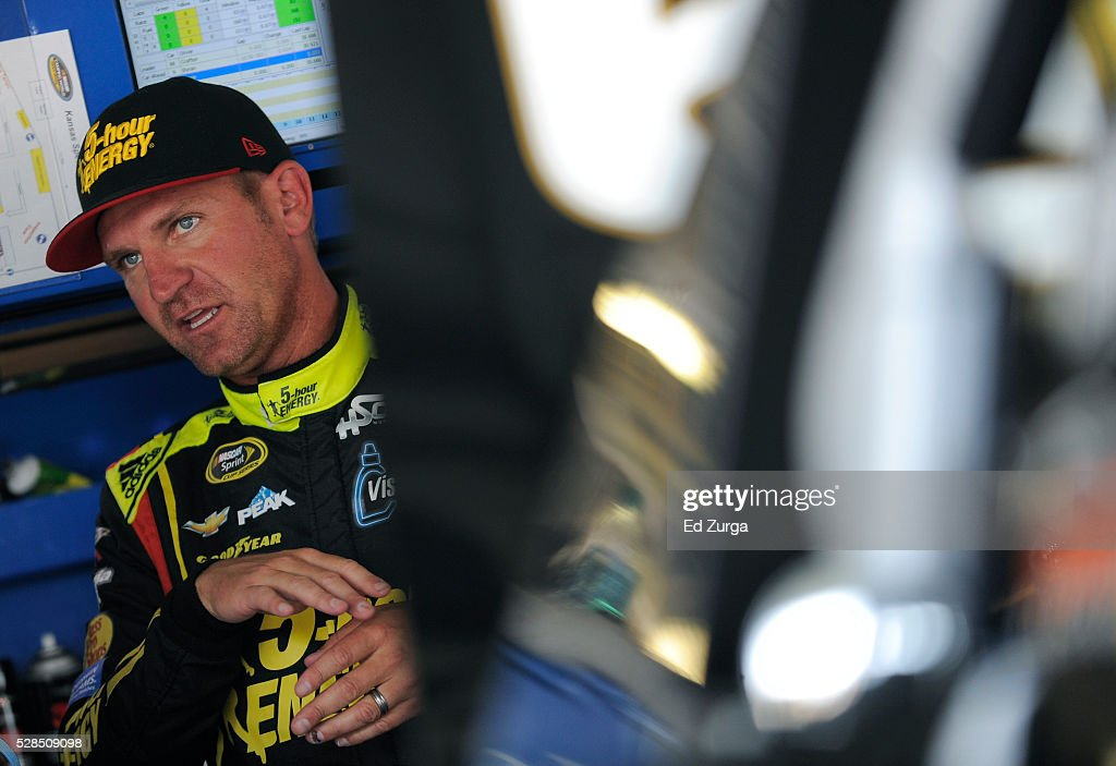 Clint Bowyer, driver of the #24 5-Hour Energy Chevrolet, talks to a member of his team after a practice sessions for the Toyota Tundra 250 at Kansas Speedway on May 5, 2016 in Kansas City, Kansas.
