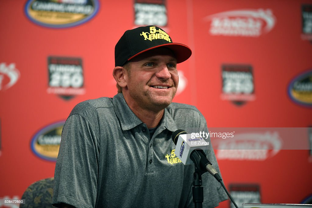 Clint Bowyer, driver of the #24 5-Hour Energy Chevrolet, talks to the media prior to a practice sessions for the Toyota Tundra 250 at Kansas Speedway on May 5, 2016 in Kansas City, Kansas.