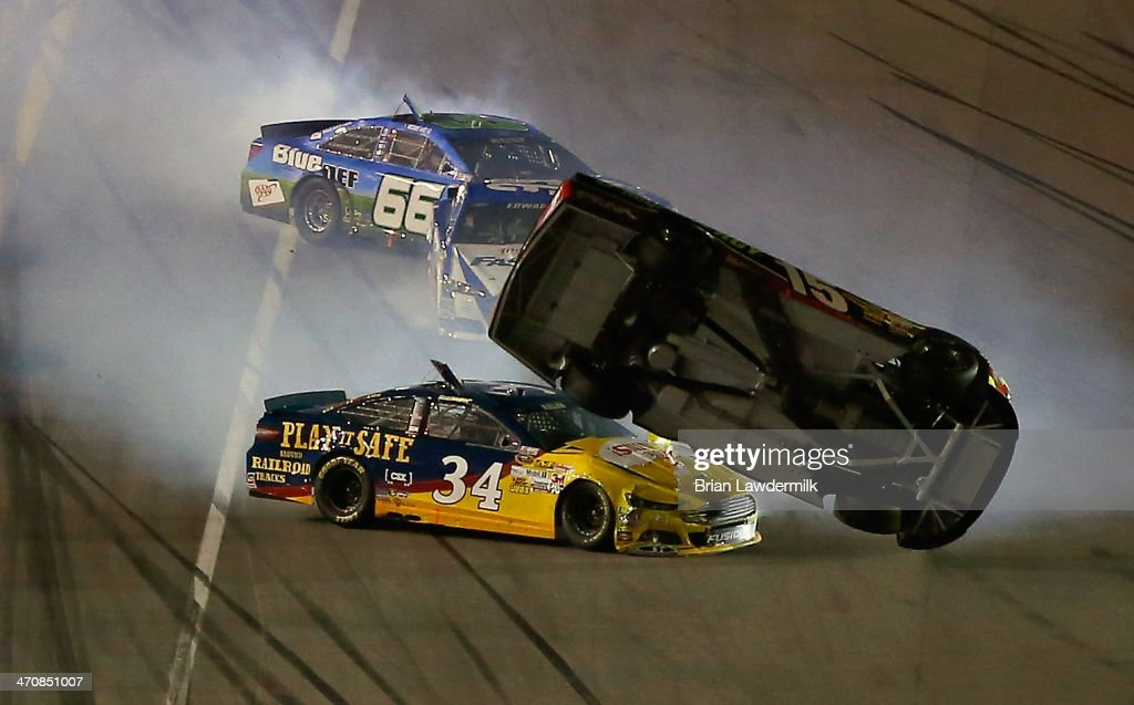 <a gi-track='captionPersonalityLinkClicked' href=/galleries/search?phrase=Clint+Bowyer&family=editorial&specificpeople=537951 ng-click='$event.stopPropagation()'>Clint Bowyer</a>, driver of the #15 5-hour ENERGY Toyota, and <a gi-track='captionPersonalityLinkClicked' href=/galleries/search?phrase=David+Ragan&family=editorial&specificpeople=574874 ng-click='$event.stopPropagation()'>David Ragan</a>, driver of the #34 CSX - Play It Safe Ford, are involved in an incident during the NASCAR Sprint Cup Series Budweiser Duel 2 at Daytona International Speedway on February 20, 2014 in Daytona Beach, Florida.