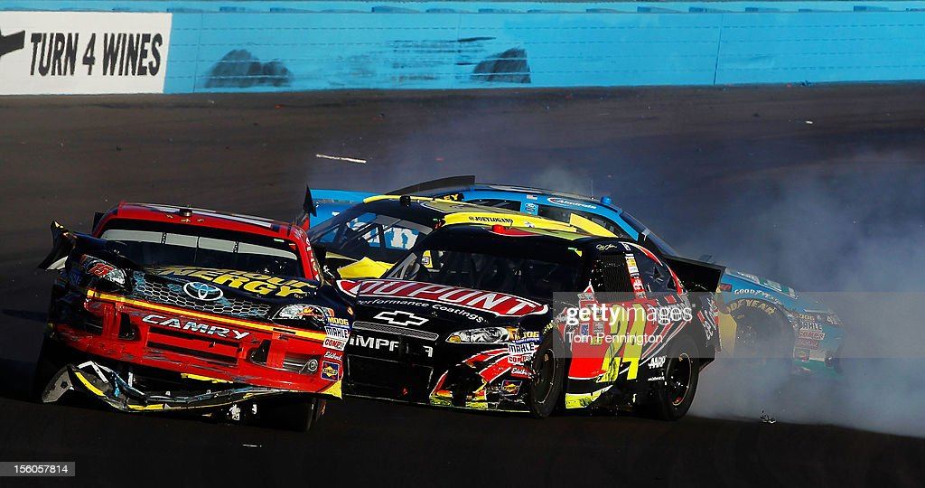 Clint Bowyer, driver of the #15 5-hour Energy Toyota, and Jeff Gordon, driver of the #24 DuPont Chevrolet, collide on track during the NASCAR Sprint Cup Series AdvoCare 500 at Phoenix International Raceway on November 11, 2012 in Avondale, Arizona.