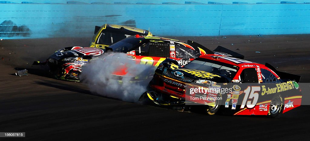 <a gi-track='captionPersonalityLinkClicked' href=/galleries/search?phrase=Clint+Bowyer&family=editorial&specificpeople=537951 ng-click='$event.stopPropagation()'>Clint Bowyer</a>, driver of the #15 5-hour Energy Toyota, and <a gi-track='captionPersonalityLinkClicked' href=/galleries/search?phrase=Jeff+Gordon&family=editorial&specificpeople=171491 ng-click='$event.stopPropagation()'>Jeff Gordon</a>, driver of the #24 DuPont Chevrolet, collide on track during the NASCAR Sprint Cup Series AdvoCare 500 at Phoenix International Raceway on November 11, 2012 in Avondale, Arizona.