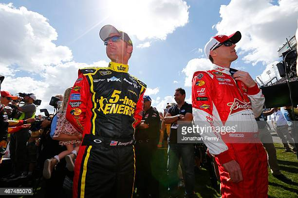Clint Bowyer driver of the 5hour ENERGY Toyota and Kevin Harvick driver of the Budweiser/Jimmy John's Chevrolet prepare for intros during the NASCAR...