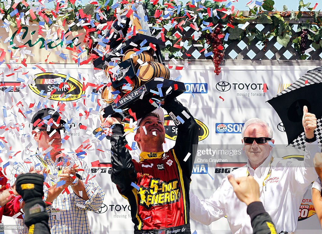 Clint Bowyer driver of the 5hour Energy Toyota celebrates in Victory Lane after winning the NASCAR Sprint Cup Series Toyota/Save Mart 350 at Sonoma...