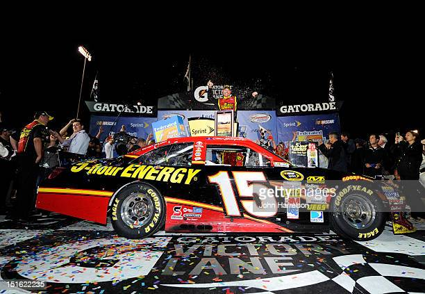 Clint Bowyer driver of the 5hour Energy Toyota celebrates in victory lane after winning the NASCAR Sprint Cup Series Federated Auto Parts 400 at...