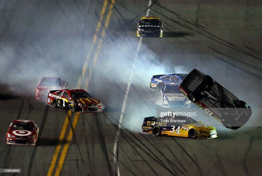 Clint Bowyer driver of the 5hour ENERGY Toyota David Ragan driver of the CSX Play It Safe Ford and Jamie McMurray driver of the McDonald's Chevrolet...