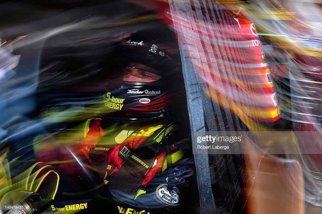 Clint Bowyer driver of the 5hour Energy Toyota in his car in the garage prior to practice for the NASCAR Sprint Cup Series Subway Fresh Fit 500 at...