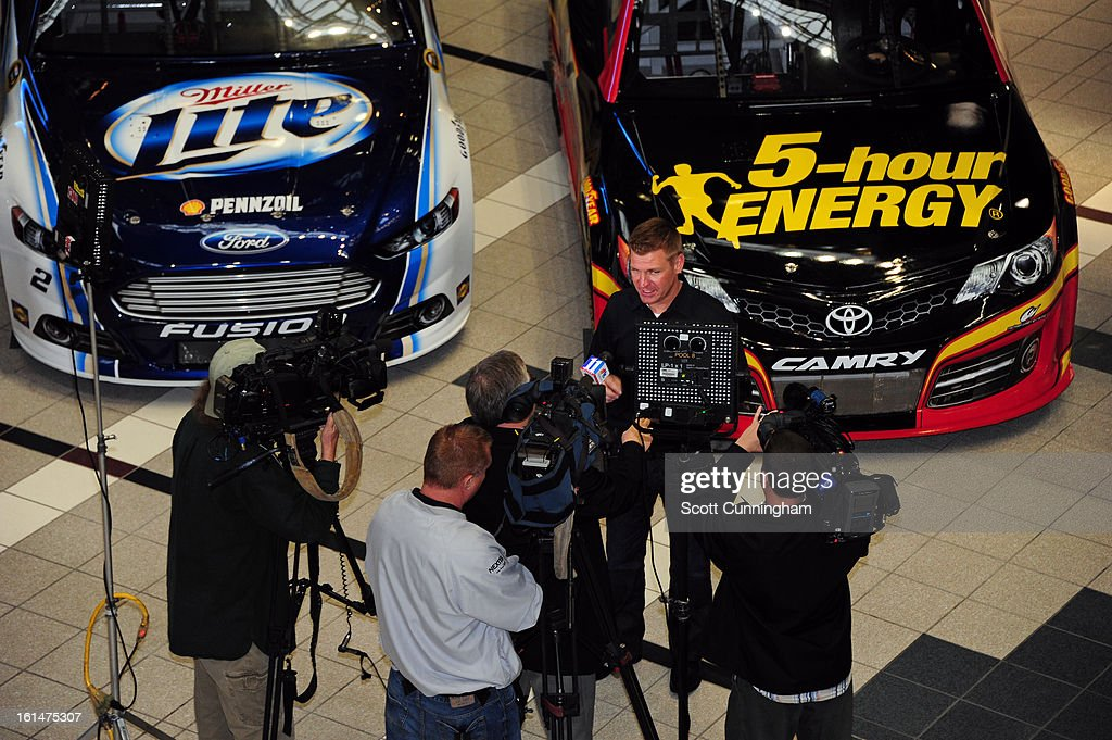 <a gi-track='captionPersonalityLinkClicked' href=/galleries/search?phrase=Clint+Bowyer&family=editorial&specificpeople=537951 ng-click='$event.stopPropagation()'>Clint Bowyer</a>, driver of the #15 5-hour Energy Toyota, is interviewed during the Road to Daytona Fueled By Sunoco at CNN Center on February 11, 2013 in Atlanta, Georgia.